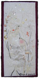 tableau textile dentelles et oiseaux